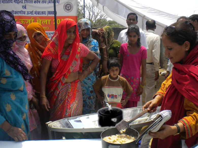 Cooking in Parabolic Solar Cooker at Village Basunda, April 2012