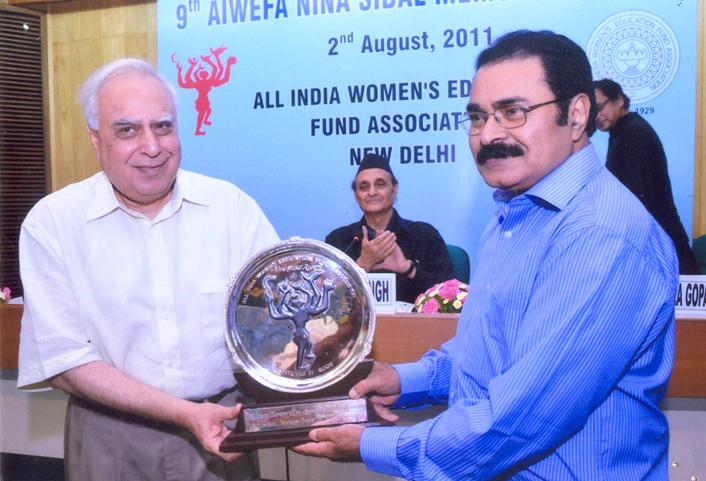 Dr. M.K.C Nair receiving the 9th Nina Sibal Award from Mr. Kapil Sibal