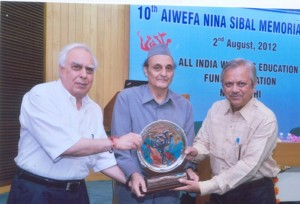 Mr. Asok Chakraborty receiving the 10th Nina Sibal Award from Dr. Karan Singh