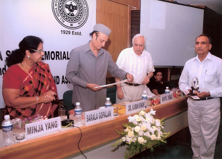 Mr. P.C. Kapoor receiving the 5th Nina Sibal Award from Dr. Karan Singh