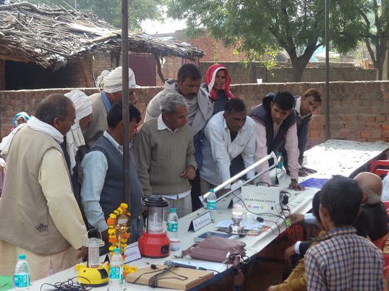 Villagers looking at Solar Equipments at Village Garhi Natthe Khan, Feb 2013
