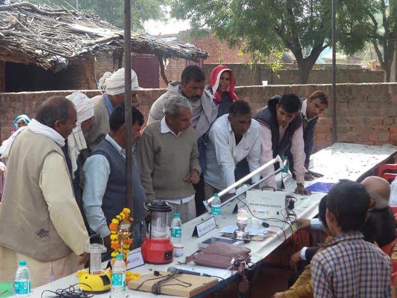 Villagers looking at Solar Equipments at Village Garhi Natthe Khan, Feb 2013