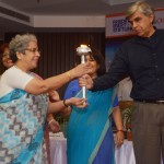 Vice Chancellor of Univ. of Delhi , handing over the Cyber Security Torch to Director, Lady Irwin College.