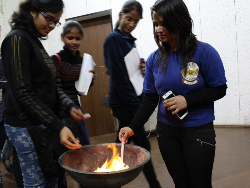 "Students , burning their negative thoughts at the on "" Promoting Intergenerational Bonding"" workshop"